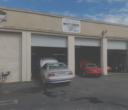 shop front with bmw and miata